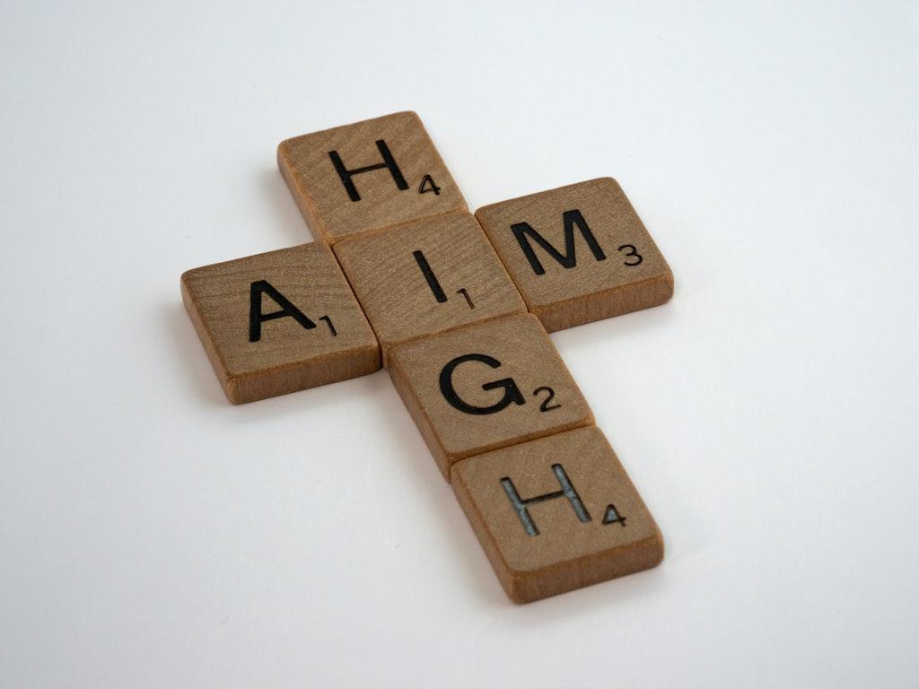 "Scrabble rocks spell the phrase ""aim high"""