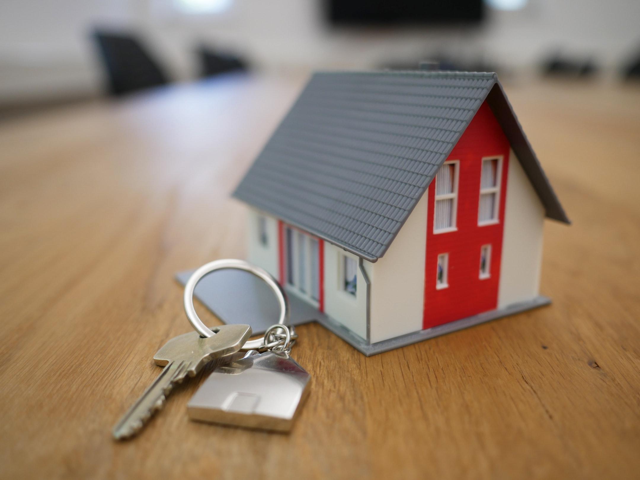 Miniature house with keys beside it